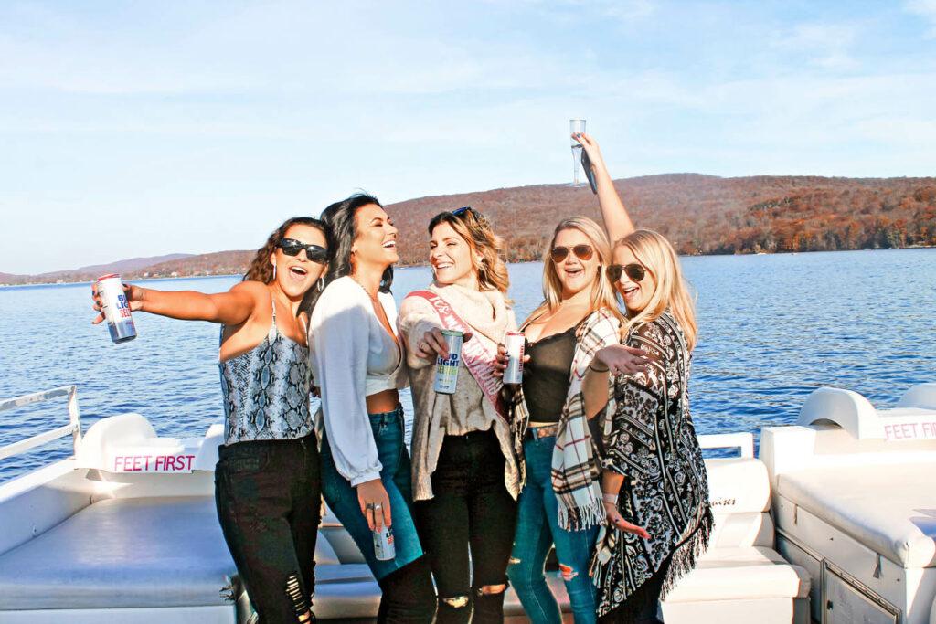 Greenwood Lake Experience girls celebrating on a boat